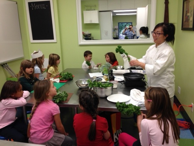 Chef Diana with kids and kale